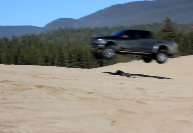 Video: Ballsy Guy Lets Friend In Raptor Jump Over Him
